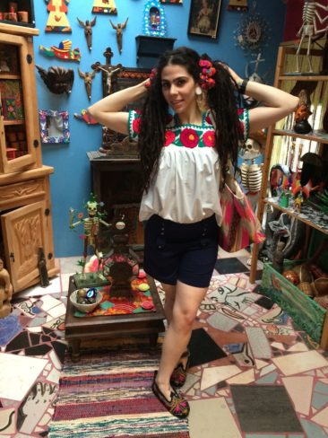 Huipil from Puebla, Mexico, $65, purse by MUCHE ET MUCHETTE, $58, hair accents from Guatemala, $8.50, shorts by EFFIE'S HEART, $58