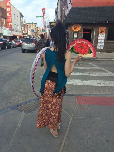 CULTURE SHOP printed skirt, $43, teal cutaway tank, $29, black leather fringe fanny pack/belt, $77
