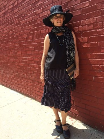 Black linen sleeveless top, black and white striped ruched skirt, black sun hat,