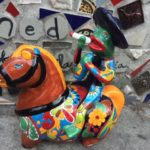 Mexican ceramic frog on a horse