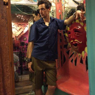 Navy short-sleeved shirt, $24, and khaki green shorts, $38.50 by LAKHAY'S COLLECTION