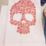Embroidered skull tea towel