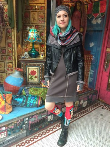 MYSTREE gray thermal dress, $65, black vegan leather jacket by SISTERS, $106, Frida knee highs, $10,  SHUPACA alpaca knit gray hat, $43.50, and fingerless gloves, $48, Indian woven scarf, $12