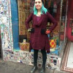 Burgundy ribbed dress by YAK AND YETI, LITTLE JOURNEYS flower knit hat, $56 and gloves, $50, Button necklace, $79.50