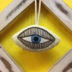 Beaded and embroidered eye ornament