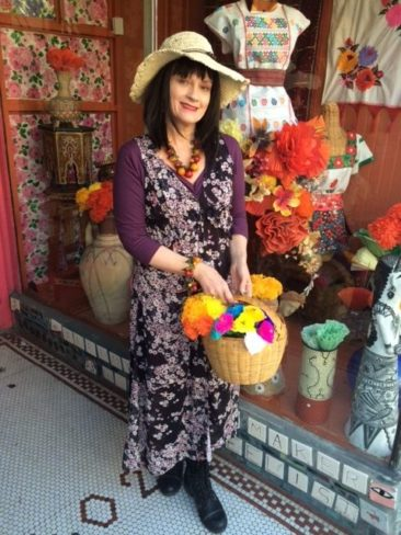 Floral duster by CLICHE, $77, straw hat by JEANNE SIMMONS, $14.50