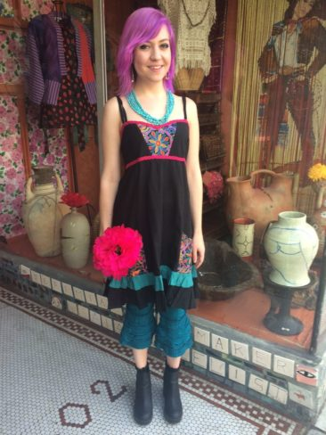 Black embroidered sundress by JEDZEBEL, $59, with teal ruffled leggings, $48
