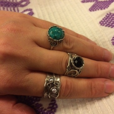 Ruth Doron rings.  From top: silver with turquoise, $53, size 7,silver with faceted black onyx, $67, size 8, silver with pearls, $62.50, size 8