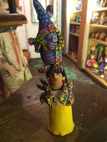 Josefina Aguilar ceramic figure balancing creatures, $45