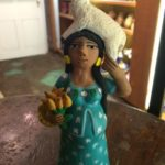 Pregnant ceramic figurine with lamb by Josefina Aguilar, $29