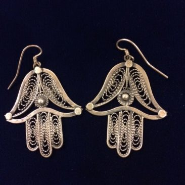 Mexican silver hamsa earrings, $165