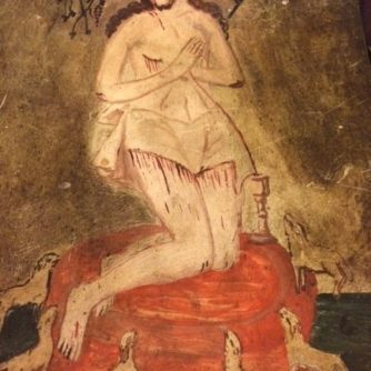 Kneeling Jesus with lambs