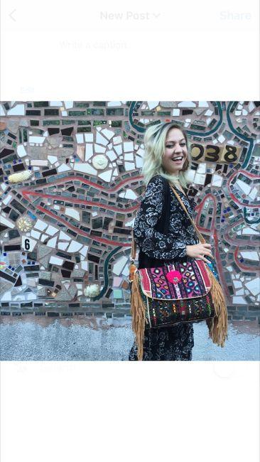 Tibetan mirrored fringe bag, $144; COTTON CANDY LA wrap dress, $46