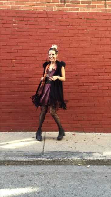 Woven fur hooded fringe vest, $70; Jersey lace dress by POL, $43; Silver chachal necklace ca 1864, $650