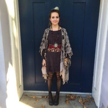 Elephant print kimono-style poncho by ANGIE, $35. Black MONORENO dress, $58. Chacha necklacel, $450 Vintage woven Peruvian belt, $110
