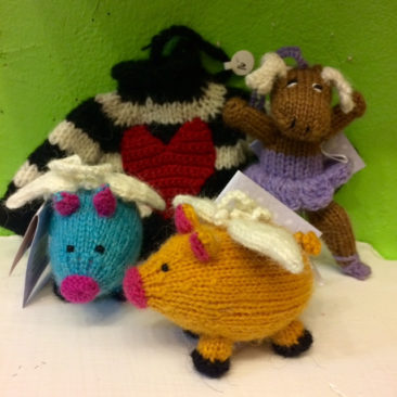Knitted animals and sweater ornaments, $15-$16