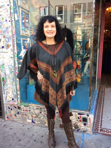 Woven gray poncho with fringe by FASHION FUSE, $58; sliced agate necklace, $45