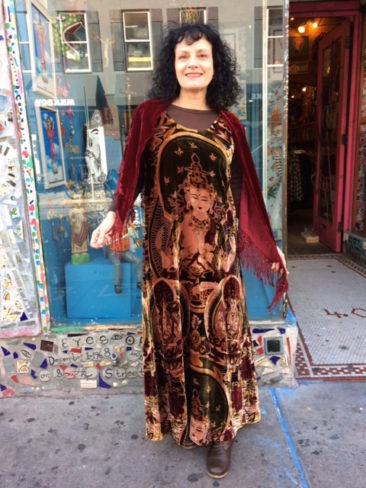 Long brown velvet Buddha dress by TAN, $70; red velvet lace-fringed shawl by J&X NY, $44.50