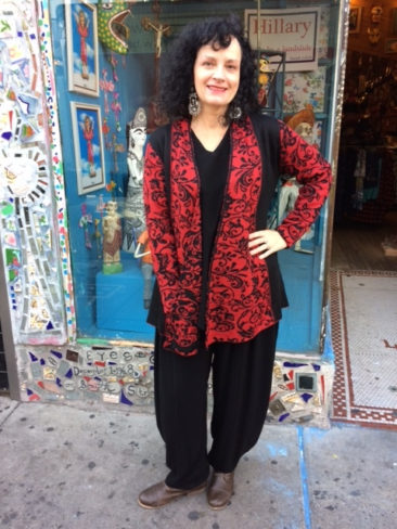 Red and black hand-crafted Peruvian sweater by TEY-ART, $192, black top by TIENDA HO, $115; black pants by TIENDA HO, $125