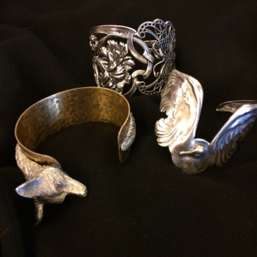 Fox cuff, $65; Butterfly and flower cuff, $86.50; Swan cuff, $82