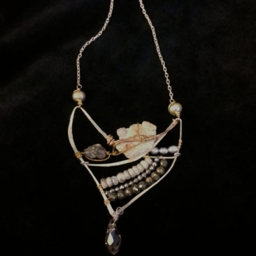 Necklace with druzy, white sapphire, pearl, and pyrite, $134 by ART BY ANY MEANS