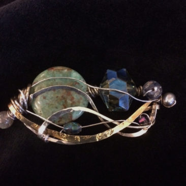 Brooch with cuprite, freshwater pearl, labradorite, and crystal, $102 by ART BY ANY MEANS