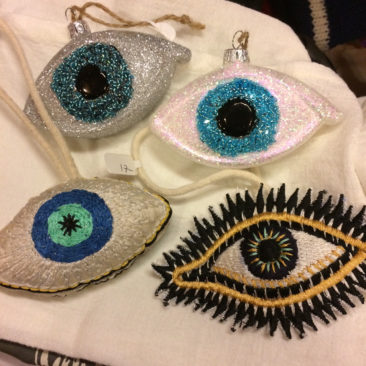 Glass eyes, embroidered fabric eyes,