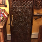 Carved wooden cabinet, $850