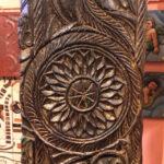 Detail of carved column coat rack, $750