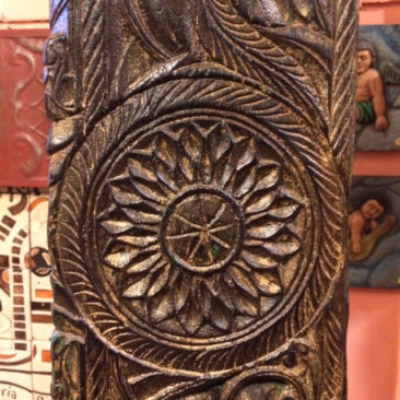 Detail of carved column coat rack, $750