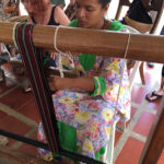 A Wayuu woman weaving a strap for a mochila bag