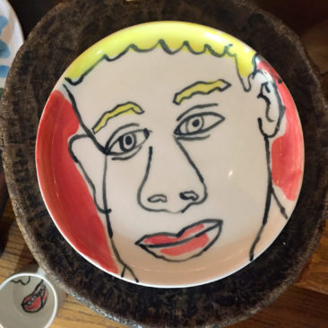 One-of-a-kind flat plate with drawing of blonde boy on red by Isaiah Zagar. Collaboration with Philadelphia studio Felt and Fat. $120