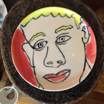 Flat Plate with Drawing of Blonde Boy on Red by Isaiah Zagar