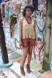 Jordan wears cotton block print shorts by NUSANTARA, $38.50, with a cream crochet halter, $29, and an African red glass necklace, $36, a Native American turquoise necklace, $225, and a vintage red bead and coin necklace from Ecuador, $154.