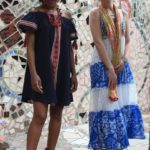 Jordan wears a denim ikat dress by THML, $58, with a vintage red bead and coin necklace from Ecuador, $154. Audrey wears a long peasant dress with embroidery and beadwork, $68, a Peruvian cotton scarf ,$29, and a Turkish collar by CHANOUR, $58.