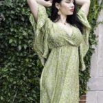 Green silk resort dress by BAIZAARSHOP, $86.50; Gold vermeil and garnet earrings from India, $168, pendant, $60