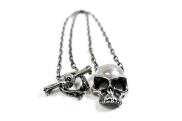 MARTHA ROTTEN skull necklace with cross bone clasp, $75. Photo by Jessica Laudicina.