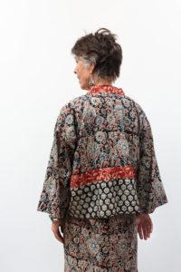 MARKETPLACE cotton batik dress, $74.50; MARKETPLACE matching kimono, $71; Tibetan turquoise and coral earrings, $28, Tibetan turquoise cuff $32