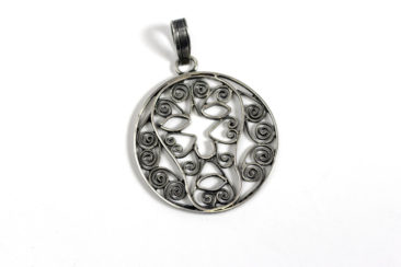 Mexican silver face pendant, $94. Photo by Jessica Laudicina.