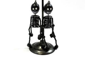 Painted ceramic skeleton earrings, $18.50