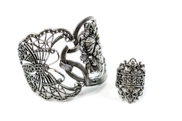 Winged insect and flower cuff, $86.50 and filigree ring by LOTTA DJOSSOU PARIS, $62.50. Photo by Jessica Laudicina.