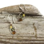 Multicolored amber and silver earrings, $38