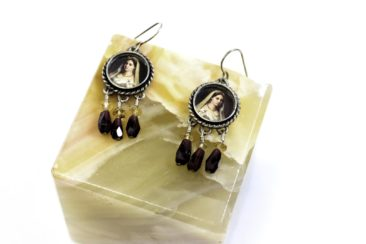 Fine Art portrait earrings with red beads, $62.50. Photo by Jessica Laudicina.