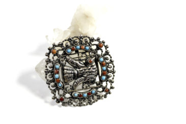 Sterling silver Mexican bird pin with turquoise and coral, $438. Photo by Jessica Laudicina.