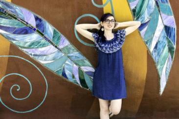 Denim eyelet mini dress by ELAN, $62.50; Pewter disk earrings, $32. Photo by Jessica Laudicina.