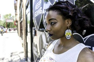 Sugar skull beaded earrings from Guatemala, $19. Photo by Jessica Laudicina. Model: Salina Miller.