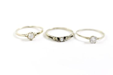 gold and white gem ring, $144; gold and pearl ring, $188, gold and white gem ring, $142. Photo by Jessica Laudicina.