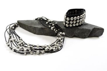 Multi-layered silver and black necklace, $38; Silver studded black leather cuff, $29. Photo by Jessica Laudicina.