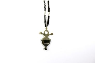 Pendant with black and gold beads, $36. Photo by Jessica Laudicina.