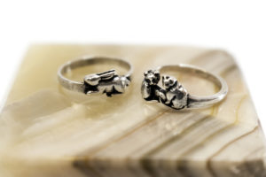 Silver rabbit ring, $17; Silver cats ring, $22. Photo by Jessica Laudicina.